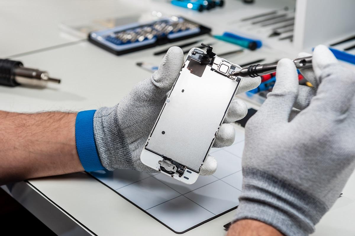 man repairing phone