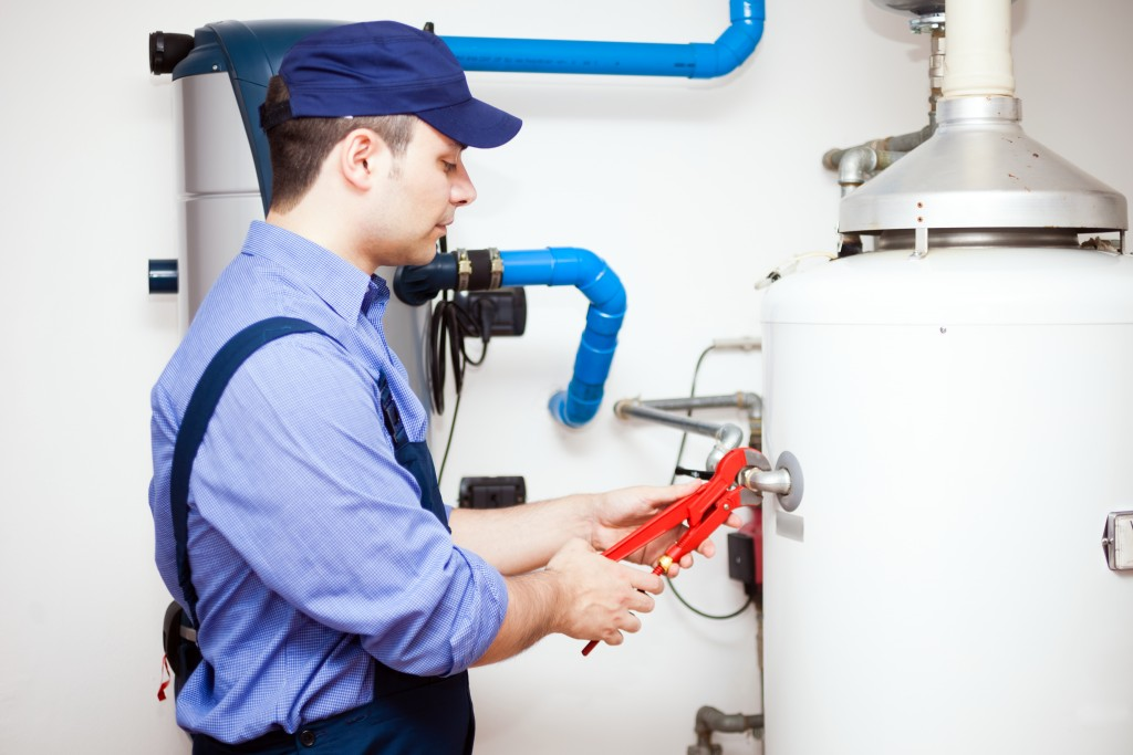plumber fixing the plumbing system