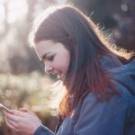 celine-using-phone
