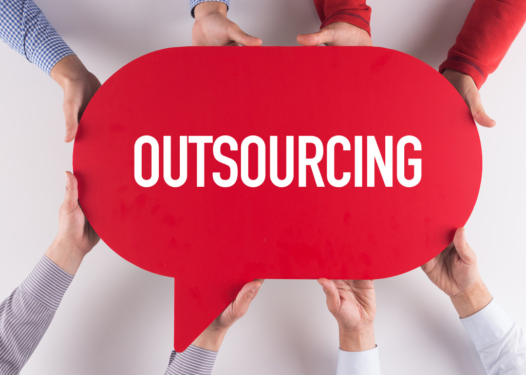 Group of People Message Talking Communication OUTSOURCING Concept