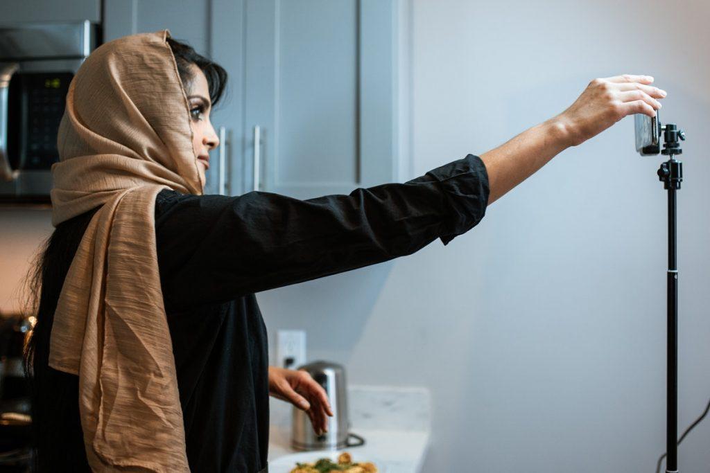 woman adjusting video