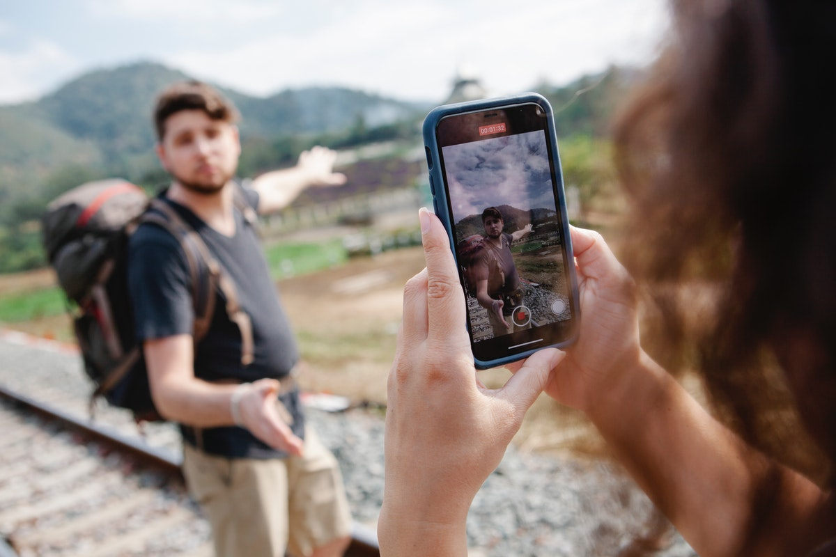 woman taking video of a man